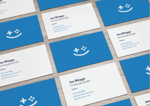 Multiple business card laid out showing a logo and contact details