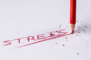 The word Stress written by a snapped crayon