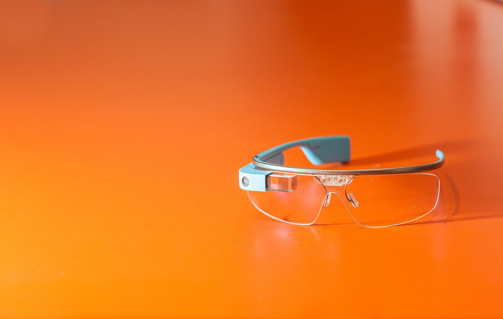 Smart glasses on orange background