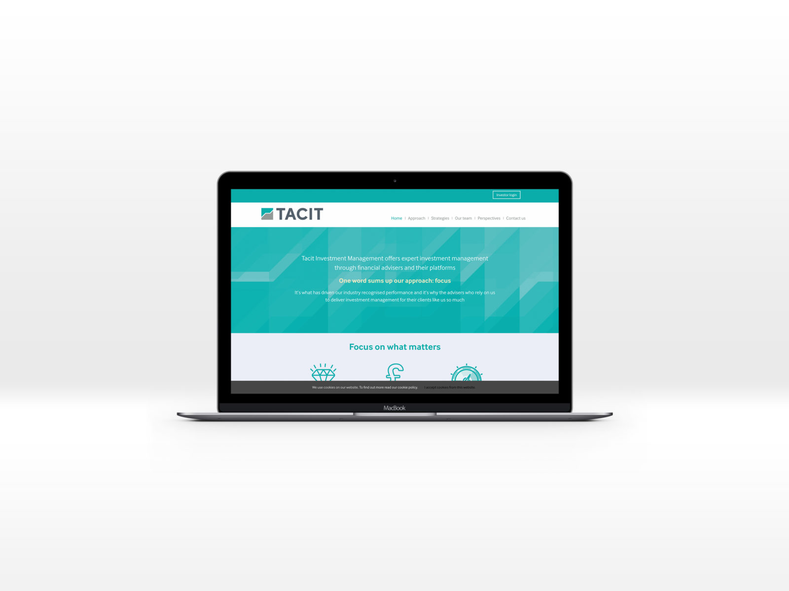 Tacit homepage displayed on a Mac laptop computer
