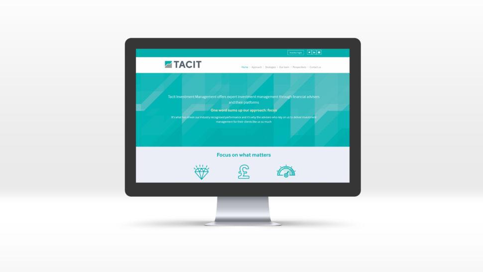 Tacit homepage displayed on a Mac desktop computer