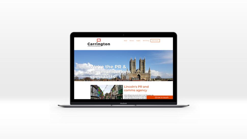 Carrington Communications homepage displayed on a Mac desktop computer