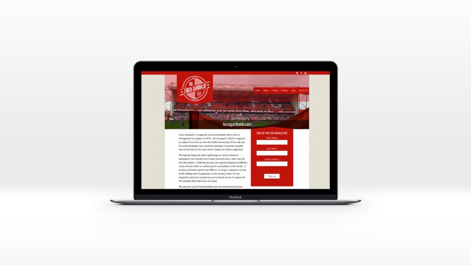 Forza Garibaldi homepage displayed on a Mac laptop computer