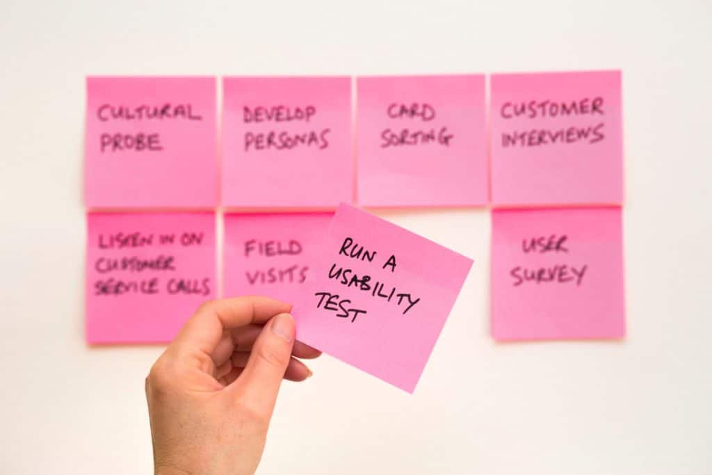 A Post-it note with 'Run A Usability Test' written inside